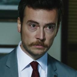 Görkem Mertsöz as Erhan Duman