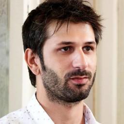 Ushan Çakır as Tolga