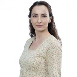 Burcu Tuna as Elvan Haksever