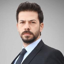 Ahmet Tansu Taşanlar as Nazım Peker